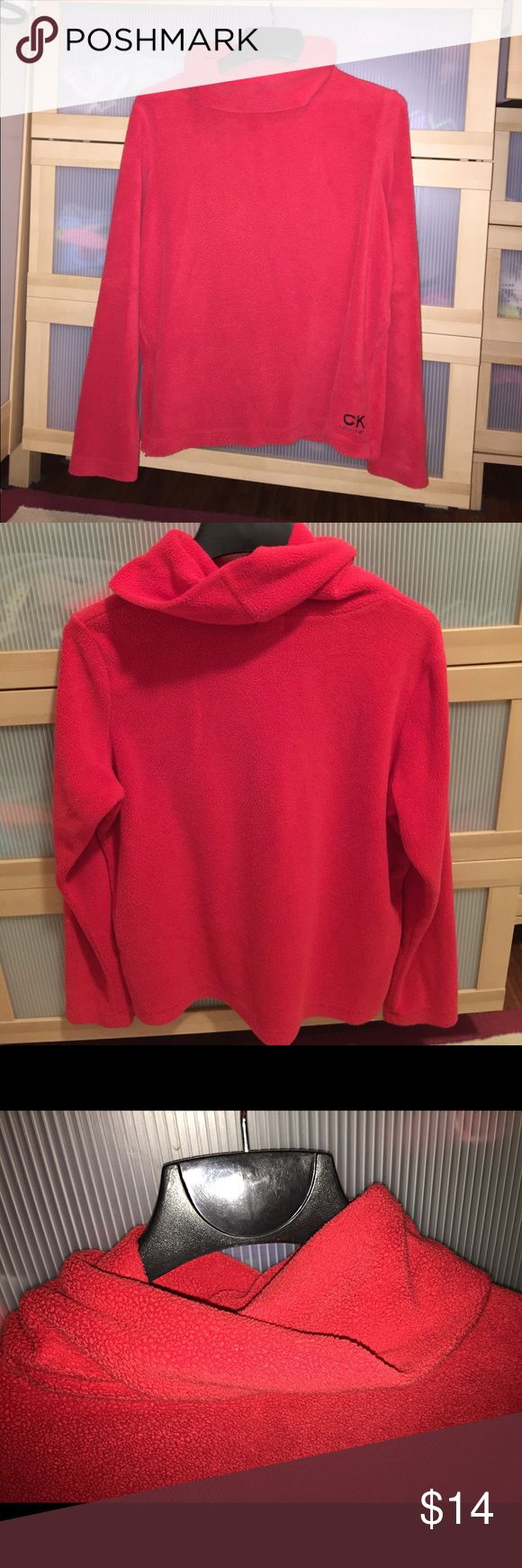 Calvin Klein sweater This Calvin Klein sweater is adorable! It is a red, soft sweater which would be perfect to wear in the fall time. It is a turtle neck which you can fold it down or just wear it as is, it will totally keep your neck warm in the winter, just like a scarf! It keeps you cozy and it's not a itchy sweater. It has two not noticeable zippers on both sides of the sweater, you can wear it zipped or not! Calvin Klein Sweaters Cowl & Turtlenecks