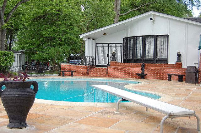 Elvis presley 39 s swimming pool at the graceland mansion in - Swimming pool marie madeleine lyrics ...