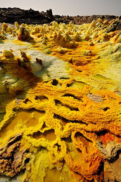 Acid lakes at the Dallol Volcano in Danakil Desert, Ethiopia | Photo by Pascal Boegli | en.wikipedia.org/...