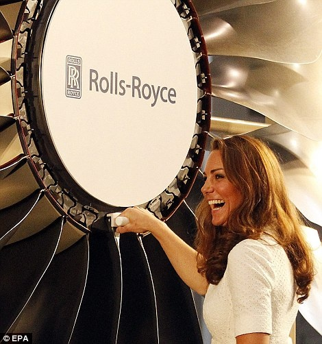 Push down: Kate unveils the first Trent 900 made at the Rolls Royce factory during a ceremony at the factory in Singapore