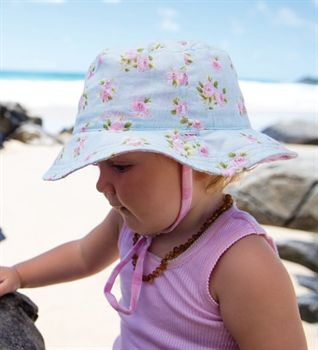 New season baby girls cotton hats. Fully reversible with 2 gorgeous styles in one hat. Toggle chin strap & UPF50+. Buy online today at MikyB!