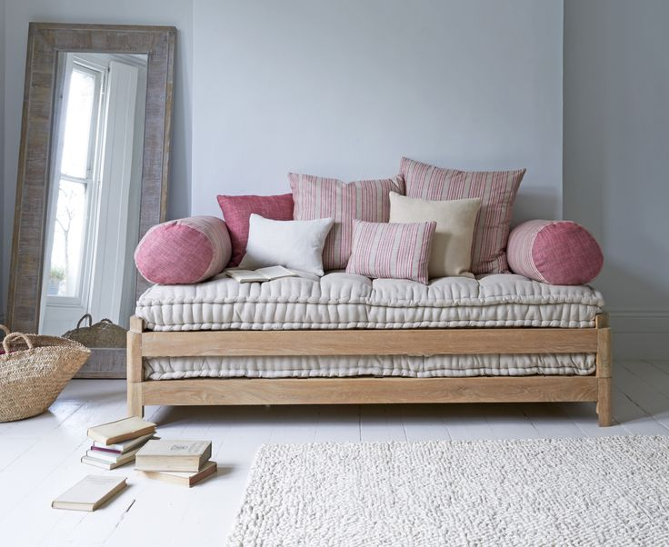 Load it up with cushions (we especially love these red striped ones)! The clever Two Pack daybed transforms into a double bed for house guests. Made from sustainably sourced weathered oak and comes with a natural linen seat cushion / mattress.