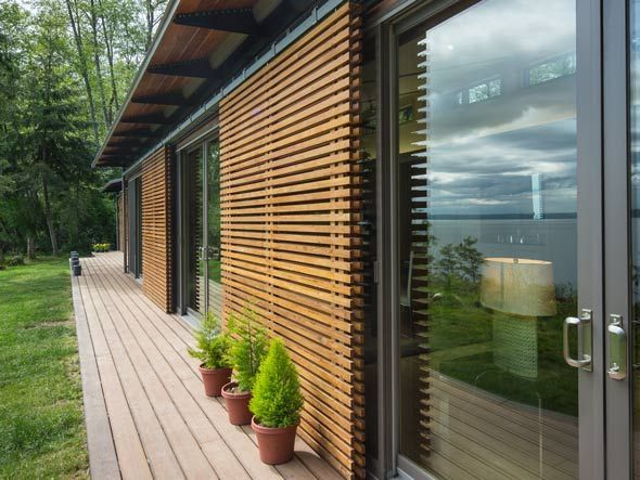 A Blu Home on Vashon Island, WA  Exterior sliding shades