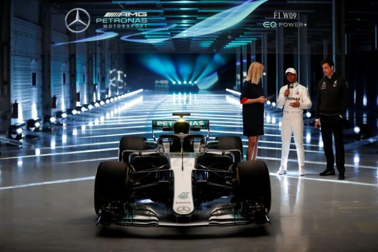Mercedes' Lewis Hamilton (centre) and team principal Toto Wolff (right) at the launch of their new F1 W09 car for the 2018 season on Feb 22, 2018.