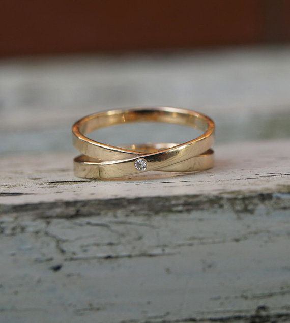 9ct yellow gold infinity ring with single diamond. The diamond is 1.5mm and flush set into a 2mm wide band. The diamond infinity ring is made