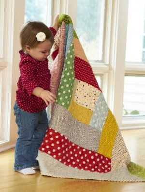 Quilts Every Child Will Treasure.  A big Log Cabin block in great bright polka dots and soft grey.