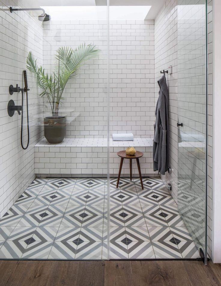 25 Inspiring Bathrooms With Geometric Tiles Shower Tile Tile Remodel Shower Tile Patterns