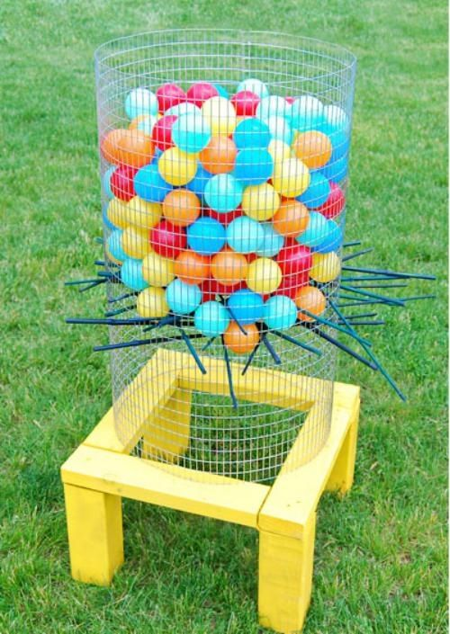 It is a hit!  Best if there are some adults to reassemble when the little ones go crazy pulling the sticks!  Balls are from Walmart, about $15 for 100.  Sticks are bamboo plant braces from Home Depot that I cut in half.  I used wire staples in the boards with zip ties to attach the wire frame so it can be dissembled easily.                                                                                                                                                      More