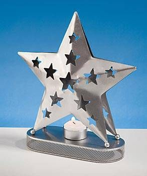 Accent your tables with this Shimmering Star Centerpiece. Each metal Shimmering Star Centerpiece is 9 inches long x 3 inches wide x 9 ¾ inches high. Candles are sold separately.