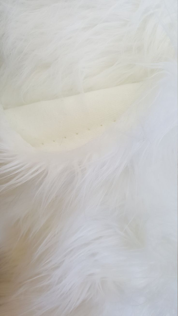 White Shaggy Faux Fake Fur Fabric by the yard 100% Polyester 58/60 Inches White Backing 1.5 inches Pile 2 lbs per yard Faux fur is not only used in clothing, can be used as a fashion accessory and hom