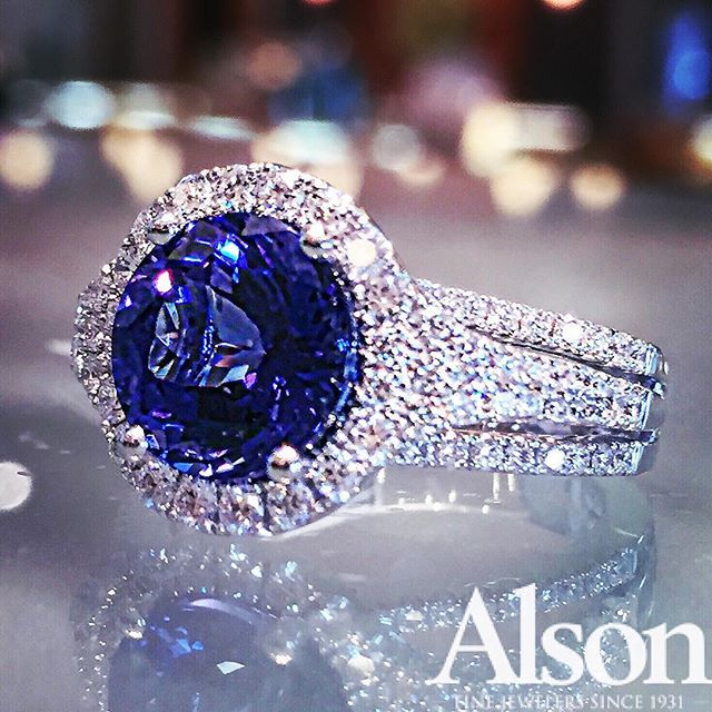 3.84 round tanzanite ring accented with diamonds.