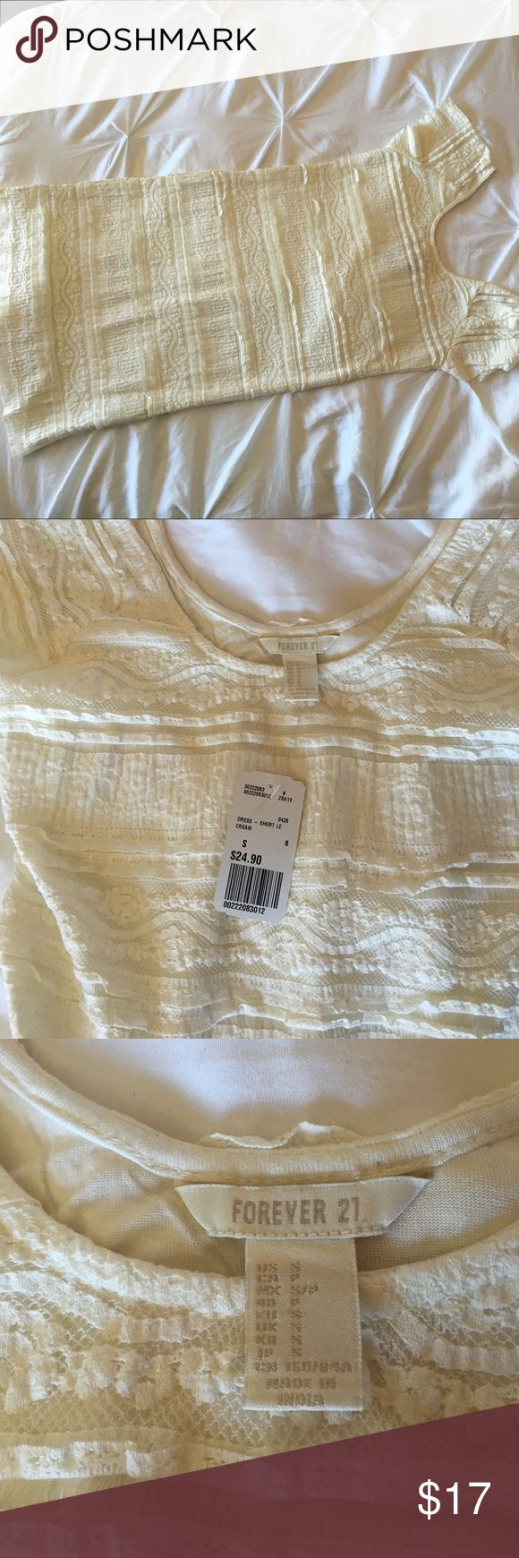 "NWT. Size small Forever 21 cream color dress. NWT. Adorable size small cream color dress! Lace overlay, fully lined underneath.  14.5"" pit to pit. Length from collar is 26 1/4"" Forever 21 Dresses"