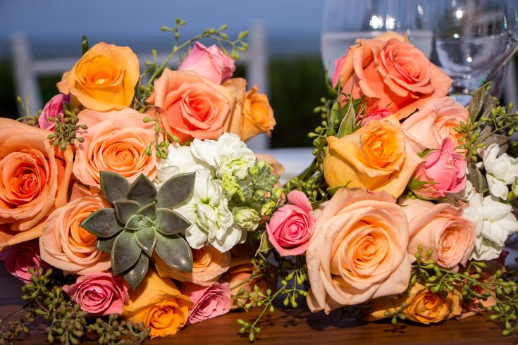 Succulents are the perfect touch to any flower arrangement here at Zöetry Paraiso de la Bonita! #WeddingFlowers #WeddingInspo #Succulents #Roses