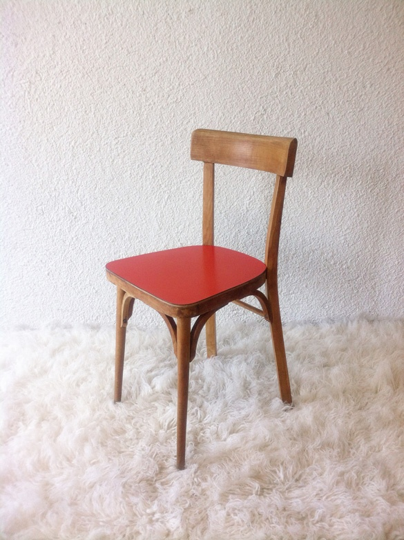wood frame chair with red Formica seat