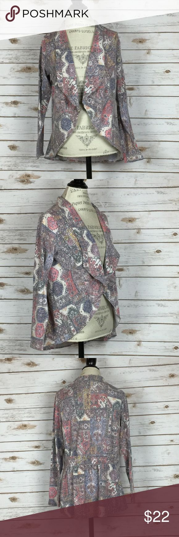 ANTHROPOLOGIE aztec print cardigan Anthropologie brand Sparrow aztec print cardigan.  Muted colors- cream, marroon, gray.  Good used condition- no outright flaws but does have minor wash wear.  Smoke free and pet free home. Anthropologie Sweaters Cardigans