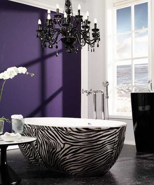 zebra bathtub and purple wall paint for bathroom decorating--but not with the tub or light or window...I just like the purple and zebra print combo idea