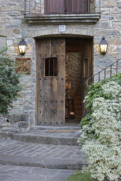 Iron Studded Wooden Doors. CASA DE SAN MARTIN . Hotel Rural . Pirineo Aragones .