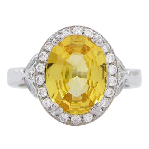 THE MARA RING WITH YELLOW SAPPHIRE  A vibrant yellow oval sapphire weighing 2.49TCW sits in a 14 karat white gold Mara ring mount. There is a halo of 24 x 1.3mm round brilliant diamonds that surround the yellow sapphire and 4 marquise diamonds with 2 little round brilliant diamond accents on the either side of the shank. The total diamond carat weight is 0.52TCW using SI clarity and F/G colour. This yellow sapphire ring is a size 6 which can also be sized. (R277