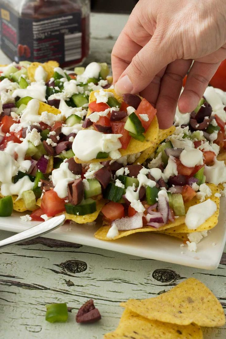 Do you like nachos? Are you a fan of a classic Greek salad? Why not combine the two and make Greek nachos? They're so delicious!
