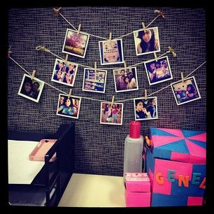 Use string to hold mini-photos in a cute display. | 54 Ways To Make Your Cubicle Suck Less