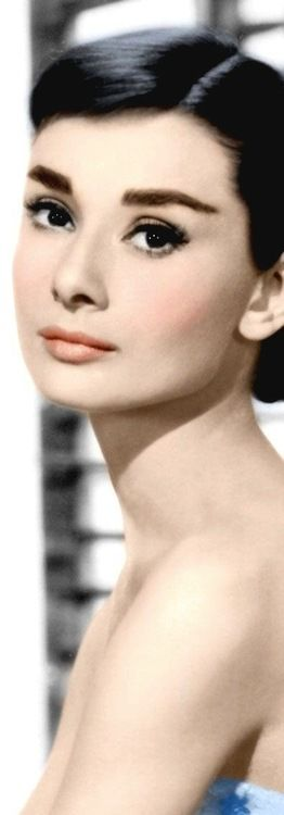 I look at Audrey Hepburn, stunning as always, for guidance on makeup for us who have brown eyes/hair.