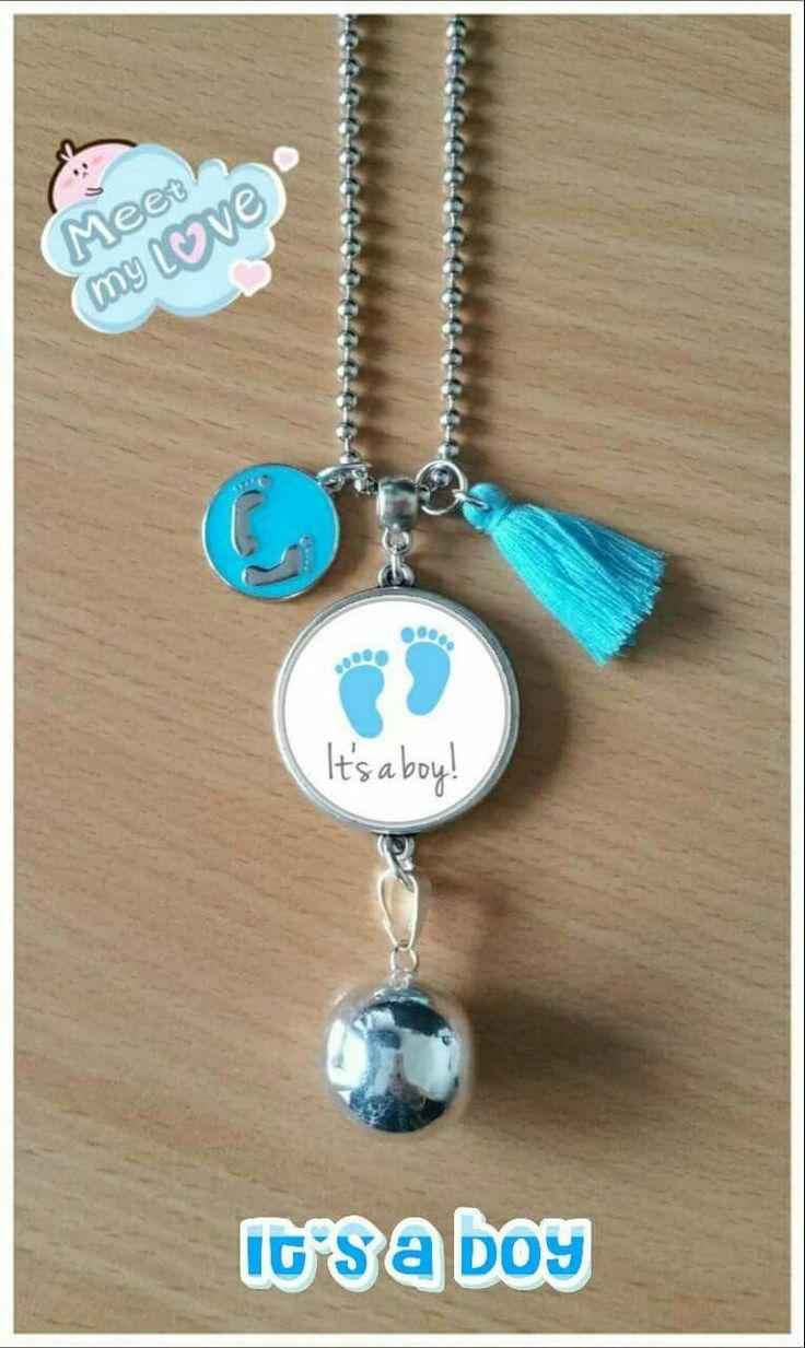 Mooie baby-bel foto-buikhanger voor uw zwangerschap van een jongen of meisje  De zilveren bel bal bevat een rinkelend geluidje, die bij elke beweging even rinkelt. In de fotohanger mag een foto naar eigen wens bijv. de eerste echo