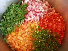 Canning Peach Salsa: 7 c (ripe, but not over-ripe) peaches, peeled, diced and set in a colander to drain a bit (save the juice for your mint tea), 1 1/4 c red onion, diced, 4 jalapeno peppers- diced (with seeds removed), 1 red bell pepper, 1/2 c fresh cilantro- loosely packed and chopped, 1/2 c white vinegar. 2 Tbs honey, 2 tsp cumin, 1/2 tsp cayenne.