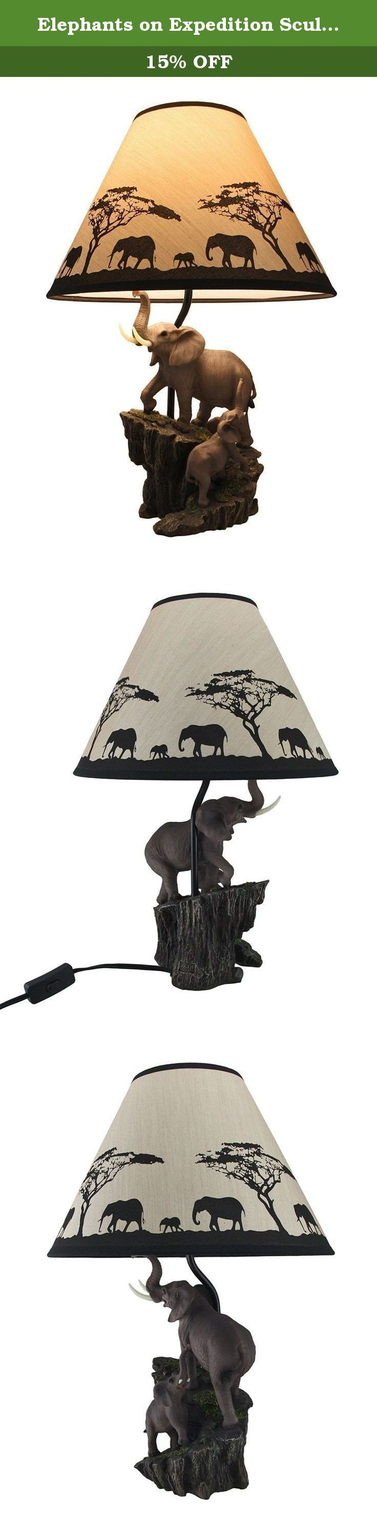 Elephants on Expedition Sculptural Table Lamp w/Decorative Shade. Featuring two elephants climbing a rocky mountainside, this sculptural table lamp is a wonderful accent in nature and outdoorsy themed rooms. This 18.5 inch tall, 7.5 inch long, 6 inch wide (47 X 19 X 15 cm) elephant lamp is expertly cast in resin with a highly detailed hand painted finish, and includes a 9 inch high, 13 inch diameter (23 X 33 cm) elephants on expedition printed fabric shade. This lamp uses 1 Type A, 40…