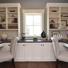 love the built in cabinets and counter around the window, also two work stations.