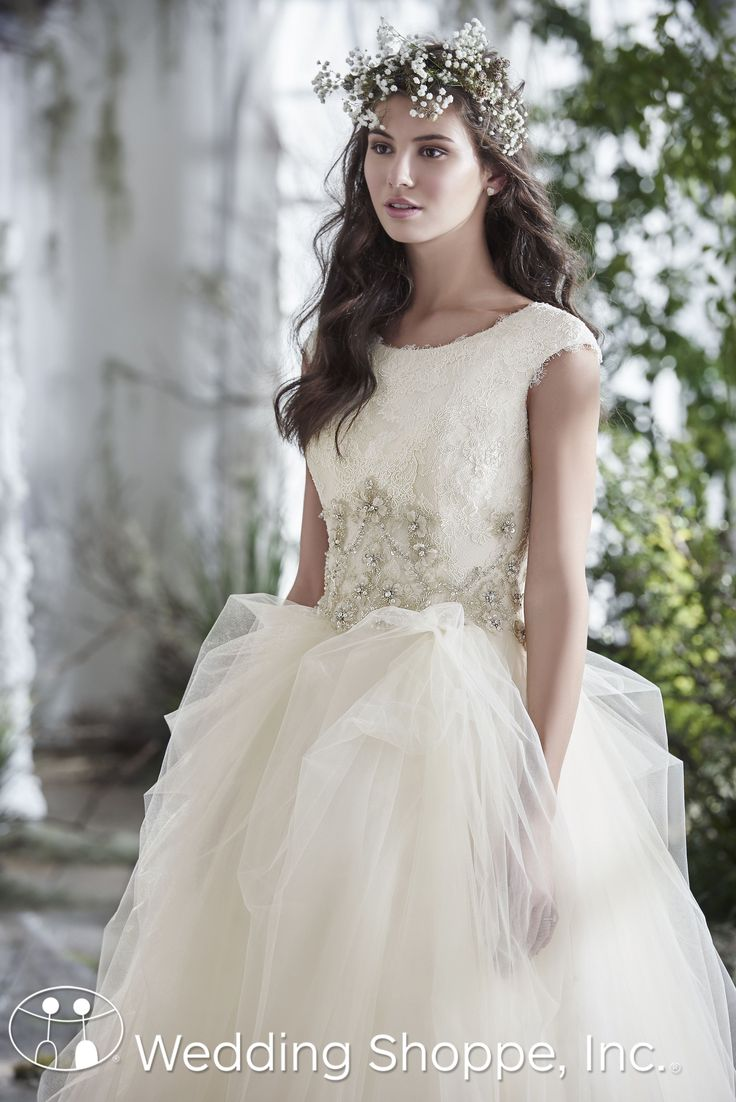 Maggie Sottero Bridal Gown Aracella Marie | Featuring a bateau neckline, cap sleeves, lace bodice with large metallic floral accents and Swarovski crystal beading, and a tulle ball-gown skirt, this truly is a breath-taking gown | The Wedding Shoppe