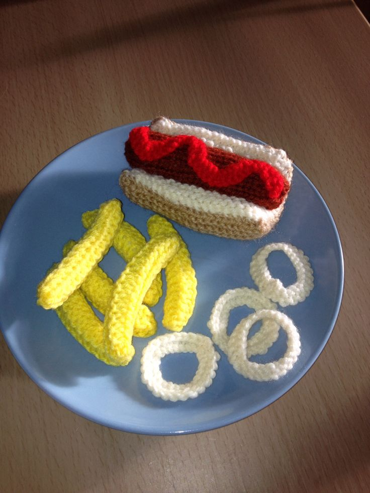 My hand knitted hot dog in a bun with tomato sauce, chips and onion rings Available to purchase from barginspls on eBay