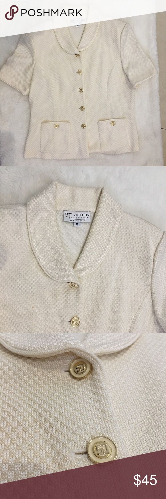 St. John Cream Beige Short Sleeve Blazer Top sz 12 Preowned authentic St. John Cream Beige Short Sleeve Blazer Top sz 12. Has faint stains. Beautiful buttons and fabric. Please look at pictures for better reference. Happy shopping!! St. John Jackets & Coats Blazers
