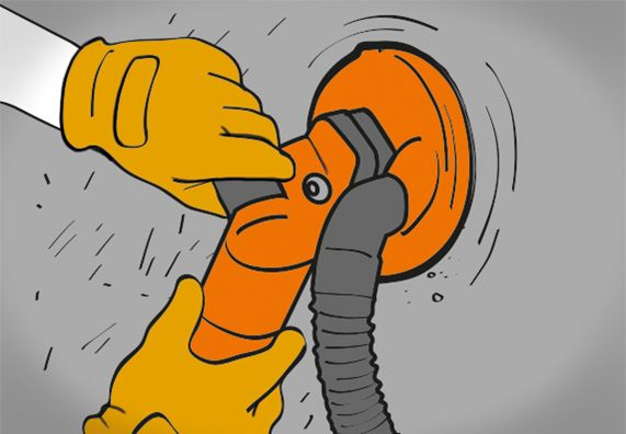 Fliesenkleber wird nach dem Entfernen der alten Fliesen mit Tellerschleifmaschine entfernt.