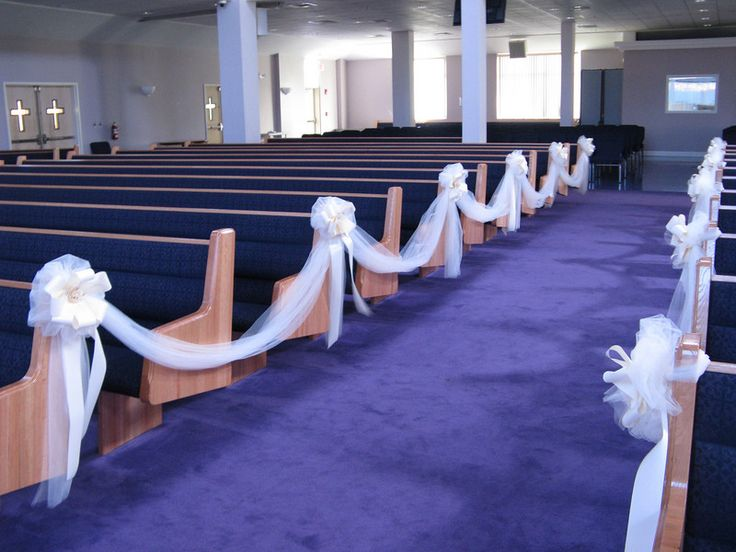decorated wedding aisle this view is from the front of the church