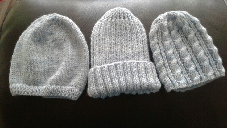 4ply prem beanies for Adam and Jake. Left pattern Sirdar early arrivals book 348 Design E; middle pattern Moda Impact Issue 4 pattern 41. 2 x 2 Rib Beanie; right pattern Twists and Cables hat by Heather Alwood - adjusted down for prem size and only using cable