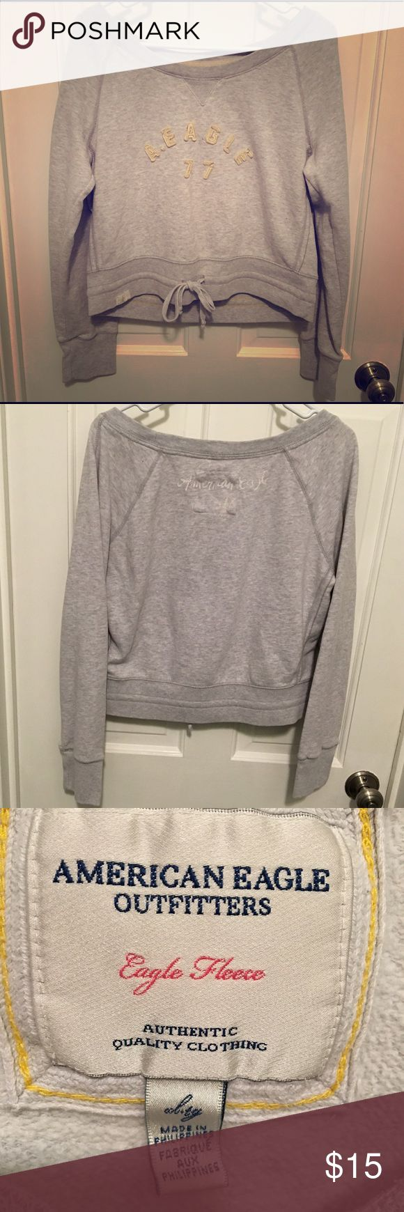 """American Eagle Sweatshirt with Tie Grey sweatshirt with tie inside the bottom band. Baby yellow/ off white Details on the front and white """"American Eagle """" printed on the back!:) very cozy and cute! American Eagle Outfitters Tops Sweatshirts & Hoodies"""