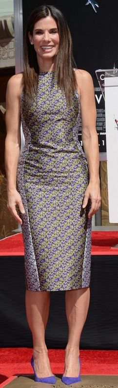 Who made  Sandra Bullock's purple pumps, floral dress, and jewelry that she wore in Hollywood on September 25, 2013?
