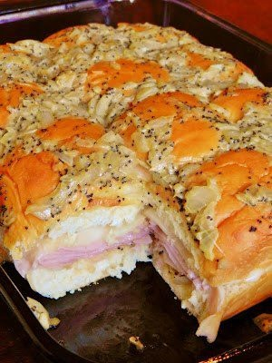 1 12 pack of King's Hawaiian Original Rolls, 1 lb. deli ham, shaved, 1 lb. Swiss cheese, thinly sliced, 1 1/2 sticks butter, 3 t Dijon mustard,1 1/2 tsp Worcestershire sauce, 3 tsp of poppy seeds, 1 onion, chopped