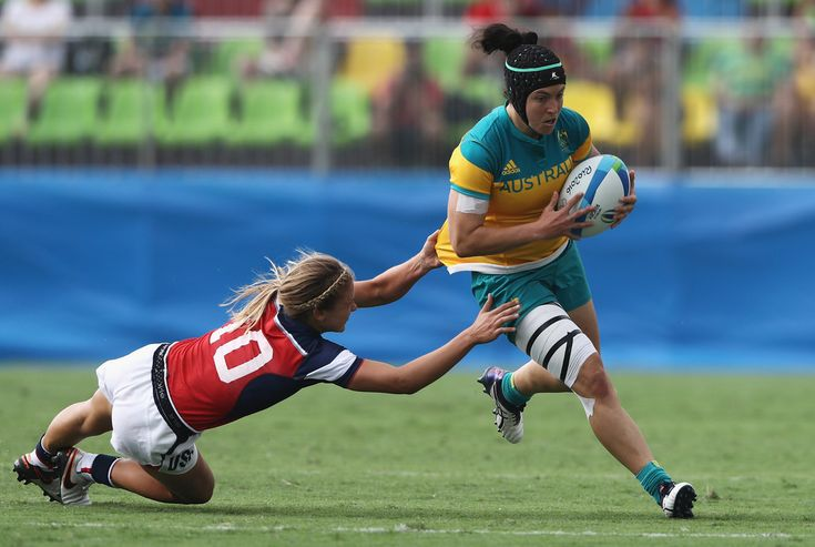 Sharni Williams of Australia carries the ball under pressure against Richelle Stephens of the United States during the Women's Pool A rugby match on Day 2 of the Rio 2016 Olympic Games at Deodoro Stadium on August 7, 2016 in Rio de Janeiro, Brazil.