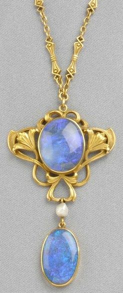 New Jersey, An Art Nouveau 14kt gold and opal pendant [necklace], Durand & Co., bezel-set with an opal cabochon within a scrolling mount with floral motifs, suspending a drop, and completed by fancy-link chain, maker's mark. #ArtNouveau #OpalPendants #OpalJewelry