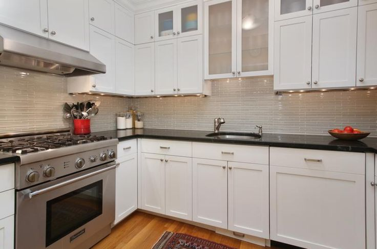 Architect Hickox Williams designed this custom chef's kitchen with high-end appliances - Bosh dishwasher, Thermador-4 burner dual fuel range, vented hood, trash compactor and built-in step stool in a magic cabinet corner