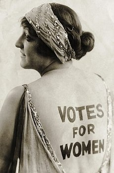 """Dorothy Newell, an outgoing young woman with a sense of humor, promotes women's enfranchisement by wearing the words """"Votes for Women"""" emblazoned on her back. Suffragists tirelessly publicized their cause in more conventional print forms, churning out banners, flyers, posters, articles, and newspapers © Underwood & Underwood/Underwood & Underwood/Corbis."""