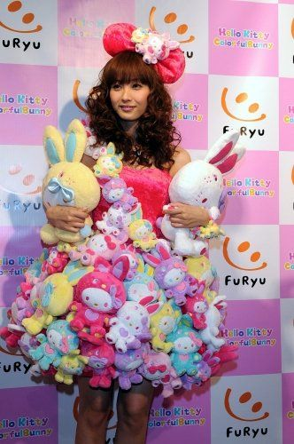Lady Gaga's Hello Kitty dress, say hello to Miki Fujimoto's Hello Kitty dress. As much as I love you with every ounce of my being Lady Gaga, I'm kind of sad to say that I think you've met your match. When it comes to dresses made out of plush Hello Kitty dolls, that is. Sure, Miki Fujimoto is a Japanese popstar, but in terms of fame, record sales and overall awesome-ness...she's got nothing on you.