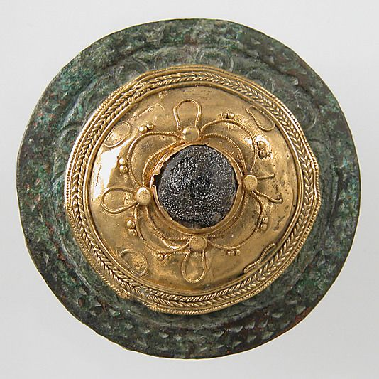 Disk Brooch  Date:     ca. 550–650 Culture:     Frankish Medium:     Gold on copper alloy, paste cabochon - The Metropolitan Museum of Art.