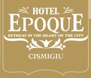 Epoque Hotel este un hotel-boutique amplasat intr-un mediu linistit chiar in centrul Bucurestiului. Epoque Hotel se mandreste cu o locatie minunata langa parcul Cismigiu, la distante mici de mers fata de cele mai importante puncte de interes din Bucuresti, peritand plimbari fara efort la Ateneul Roman sau Casa de Opera Bucuresti.  Pentru cei ce tranziteaza, Hotel Epoque este, in mod convenabil, localizat in imediata apropiere de zonele business sau banci.