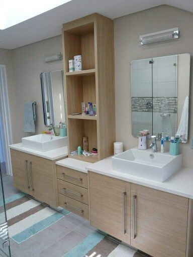 Oak Melamine & vinyl wrap vanity unit with White Vicostone tops.