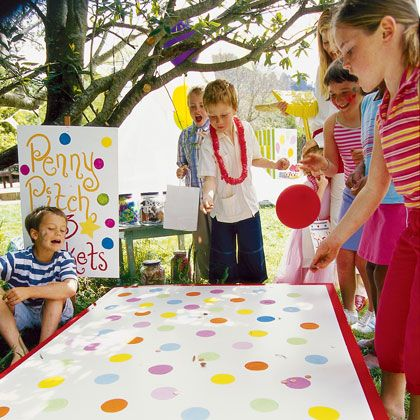 Penny Pitch! Few midway games are as simple, or simply addictive, as this. Your tickets get you a fistful of pennies, which you toss one by one onto the game board, trying to land one on any of the colored circles to win a prize.   **For more birthday party games visit http://www.partycanada.blogspot.com
