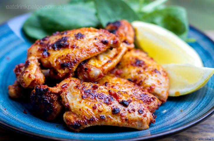 Sticky Portuguese Paleo Chicken Wings Recipe Main Dishes with chicken wings, coconut oil, garlic, lemon, lemon, tomato paste, coriander seeds, onion powder, coconut aminos, coconut oil, sea salt