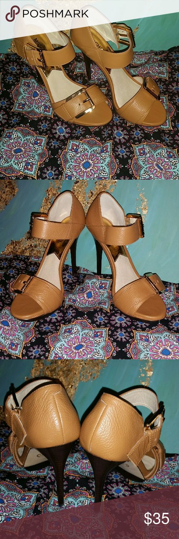 """Michael Kors tan high heels. Sz 8  (NWOT) Very nice in like new condition.  Sz 8 Tan Michael Kors high heels.  No marks, scuffing or noticeable wear  5"""" spike heel with gold tone buckle  Strap at toe and ankle.  Michael Kors embossed buvkle hardware Michael Kors Shoes Heels"""