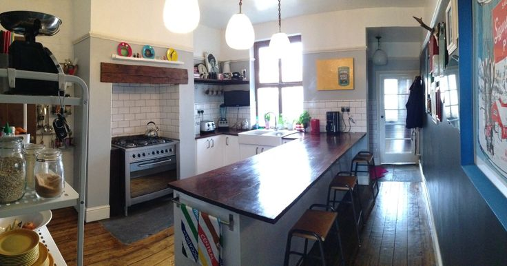 Heart of my home. Reclaimed countertops and lights.